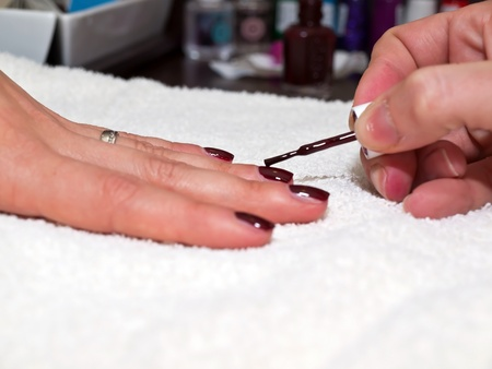 Painiting nails in red color close up Stock Photo - 13866891