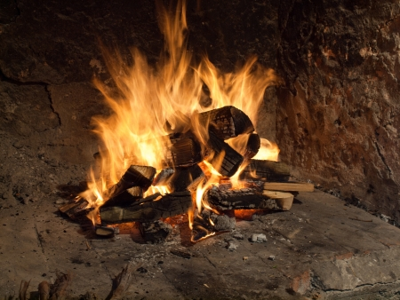 Image shows a fire in old fireplace Stock Photo - 13997134