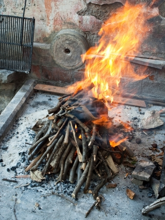 Image shows a burning fireplace in old village Stock Photo - 15551434