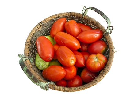 Fresh red tomatoes and peppers in vegetable basket Stock Photo