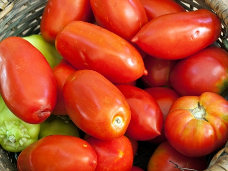 Image shows a tomatoes and peppers in basket Stock Photo