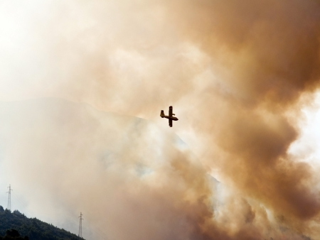 Fire fighter airplane in smoke in great action Stock Photo - 15568901