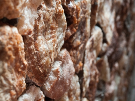 deatil: Gleaming old red stone outdoor background
