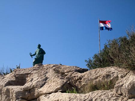 saint peter: Saint Peter monument with Croatian flag in Makarska
