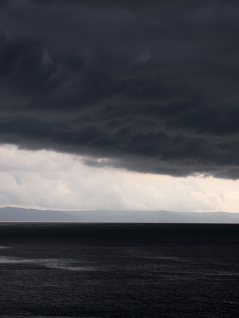 View at stormy clouds over sea Stock Photo