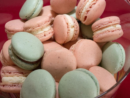 French macaron cakes close up in bowl Stock Photo