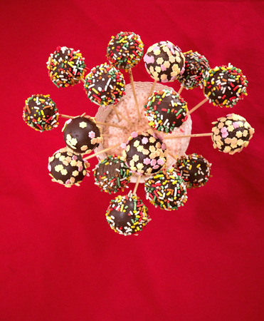 wit: Colorful chocolate cakepops wit sprinkles top view Stock Photo