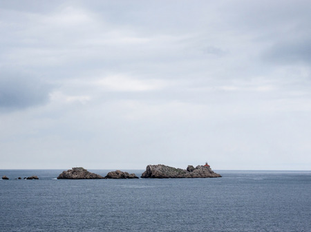 Rocky island with small lighthouse near Dubrovnik