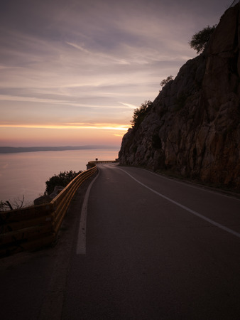 Mountain road  in Croatia above the sea at sunset Stock Photo