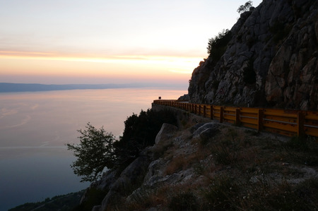 Scenic mountain road  in Croatia above the sea at sunset Stock Photo