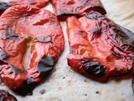 Roasted red peppers with olive oil close up
