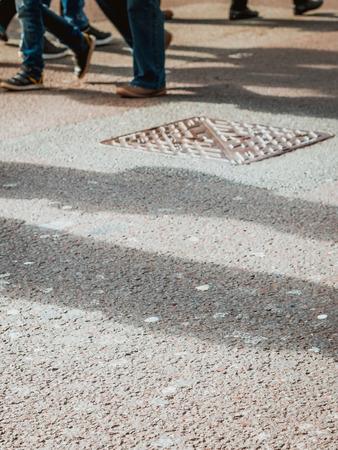 People walking on the street crossing Stock Photo