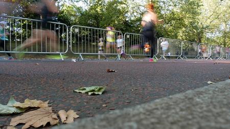 Blurred runners on marathon, focus on ground Stock Photo