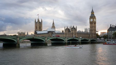 Boat passing on Thames river near Westminster palace