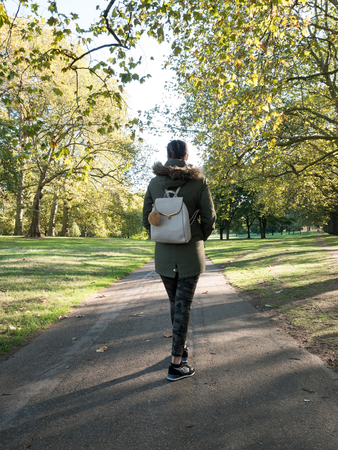 Woman walking in the park at morning Stock Photo