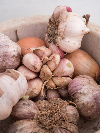 Organic garlic and onions in kitchen