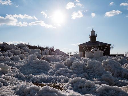 Landscape scene of lighthouse on Adriatic sea coast on sunny day