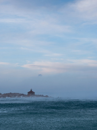 Lighthouse on sea storm and strong north wind