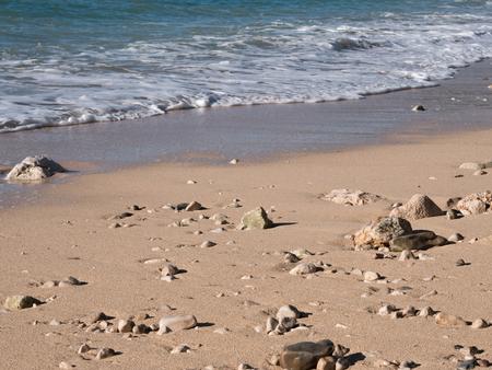 Sand beach and blue sea at evening on Adriatic sea coast in Croatia