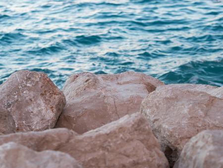 Rocky coastline and blue sea at sunset Stock Photo