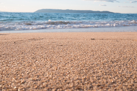 Sand beach and blue sea with waves landscape