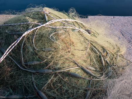 Fishing net close to the calm blue sea