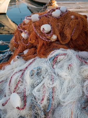 Fishing nets on wooden dock in port