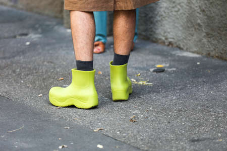 September 24, 2020: model is wearing a pair of green rubber boots during the Fendi fashion show at the women's men's fashion week spring / summer 2021