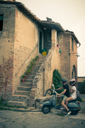 ghost town: Visitors at abandoned village in Toiano, little ghost town in Tuscany, Italy Stock Photo