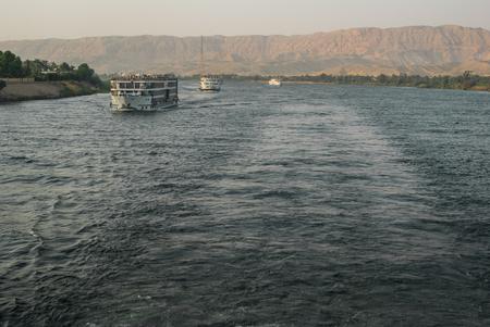 touristic: Large touristic cruise boat traveling along the river Nile, Egypt Stock Photo