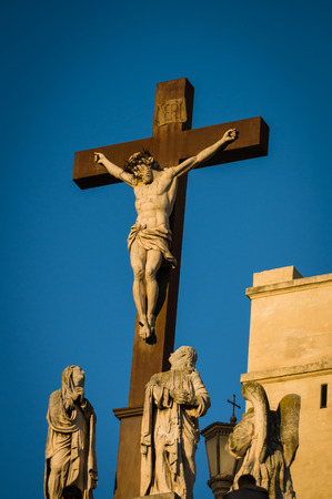 southeastern: Statue of Jesus Christ at cross at the Palace of the Popes in Avignon a French commune in southeastern France