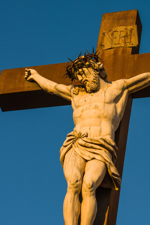 commune: Statue of Jesus Christ at cross at the Palace of the Popes in Avignon a French commune in southeastern France