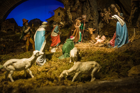 creche: Gubbio, Italy - October 2015 - Permanent Christmas Manger scene with figurines including Jesus, Mary, Joseph, sheep and magi. Italy. 2015