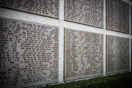 seconda guerra mondiale: Florence, Italy - November 2015 - Names of Second world war casualties on a tribute wall  in American Second World War Cemetery in Florence, Italy. 2015