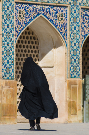 esfahan: Esfahan, Iran - February 2016 - Muslim woman with traditional chador on the street. Iran, 2016 Editorial