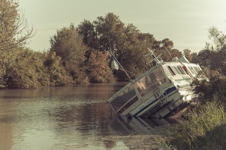 sunken: A sunken wooden boat in a river in France Stock Photo