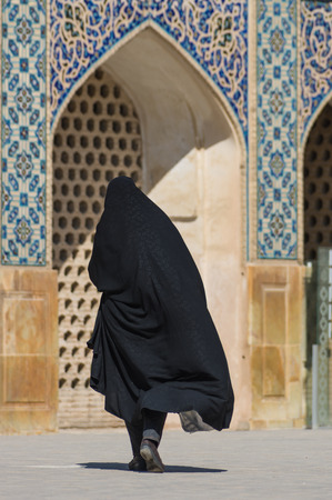 Esfahan, Iran - February 2016 - Muslim woman with traditional chador on the street. Iran, 2016 Editorial