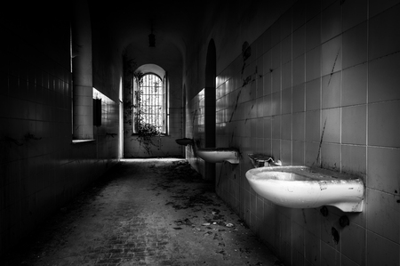 madhouse: Volterra, Italy - September 2016: Abandoned psychiatric hospital in Volterra. It was home to more than 6,000 mental patients but was shut down in 1978 because its practices were deemed cruel. The hospital was called the place of no return because patien