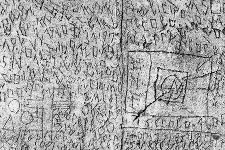 Volterra, Italy - September 2016: A mysterious series of runes, symbols and letters are scratched into the 180-metre-long courtyard walls, the work of former patient Oreste Ferdinand Nannetti. Psychiatric hospital in Volterra was home to more than 6,000 m