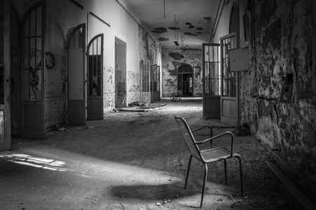 Volterra, Italy - September 2016: Abandoned psychiatric hospital in Volterra. It was home to more than 6,000 mental patients but was shut down in 1978 because its practices were deemed cruel. The hospital was called the place of no return because patien