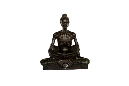subduing: buddha seated cross-leg in attitude subduing himself isolate on white Stock Photo