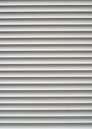 White shutters over a shop doors photo
