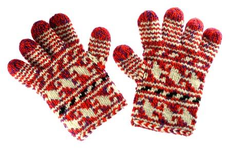ropa invierno: Invierno guantes rojos aislados en blanco