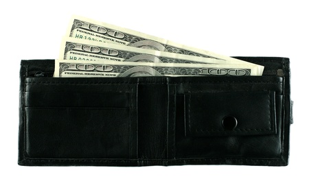 Leather wallet with some dollars inside photo