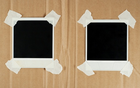 Two blank photo cards with masking tape on a cardboard photo