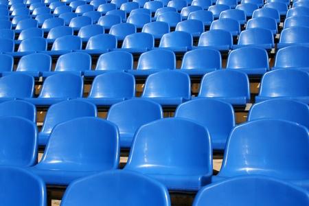 Empty plastic seats in a stadium photo