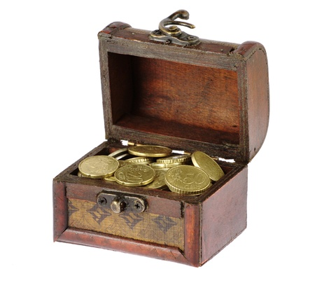 Wooden casket full of coins isolated on white photo