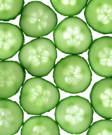 Cucumber slices isolated on white photo