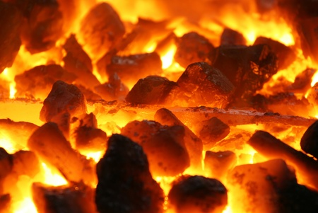 glowing coals with metal stuff background texture photo