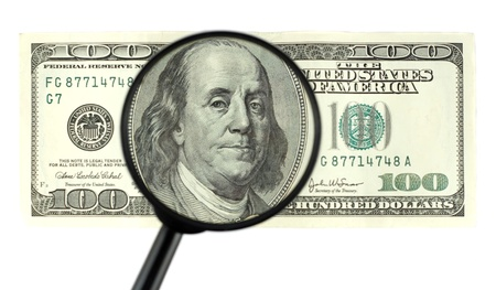 Closeup of $100 banknote - franklin portrait through the magnifier photo